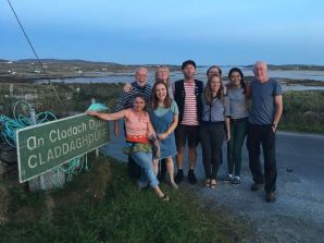 The London Sea Shanty Collective by a road sign in Claddaghduff