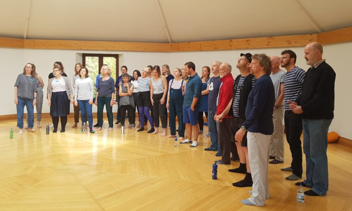 The London Sea Shanty Collective rehearse in a hall in Cork