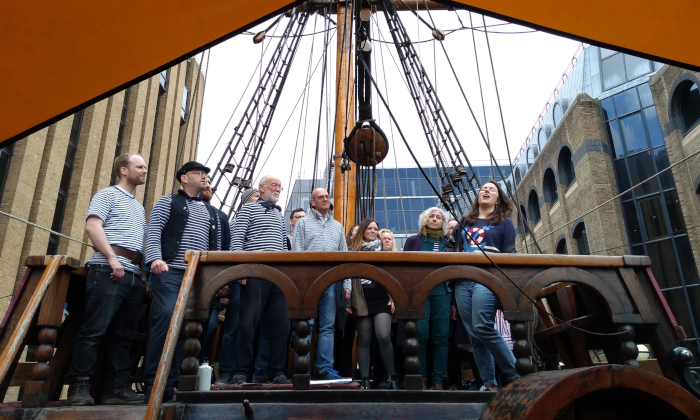 The London Sea Shanty Collective singing on the Golden Hinde