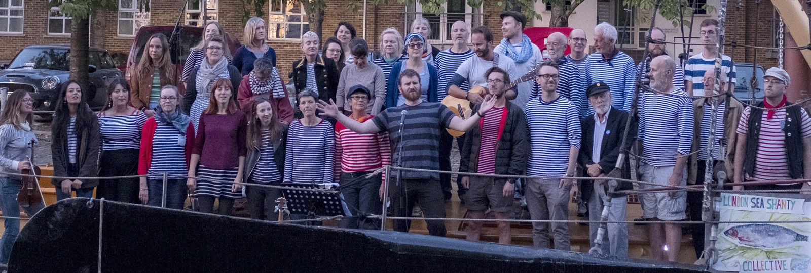 The London Sea Shanty Collective sing on the Thames barge Melissa at Greenland Dock